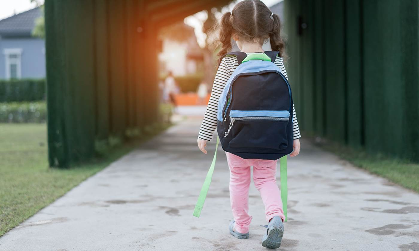 Little girl walking alone after learning