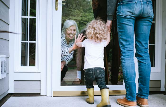 Little girl visits her grandparents with her parents