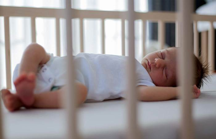 Baby sleeping in cot