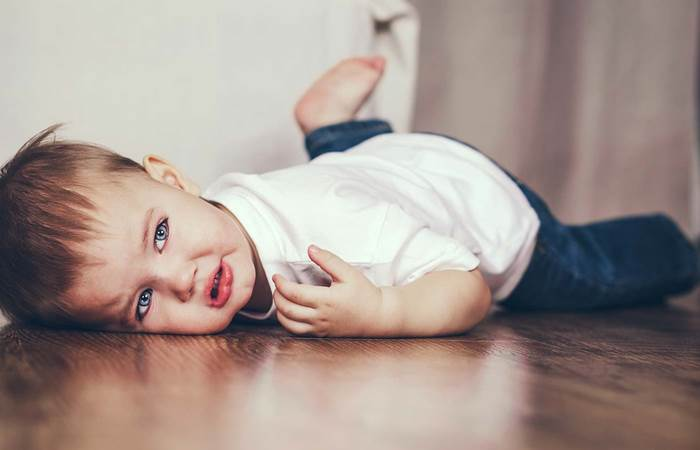 Toddler lying on the floor