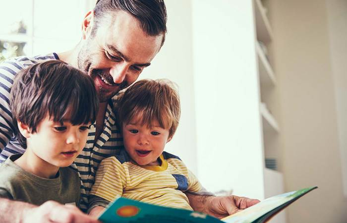 Father and sons reading