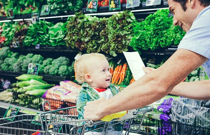 Father and child grocery shopping