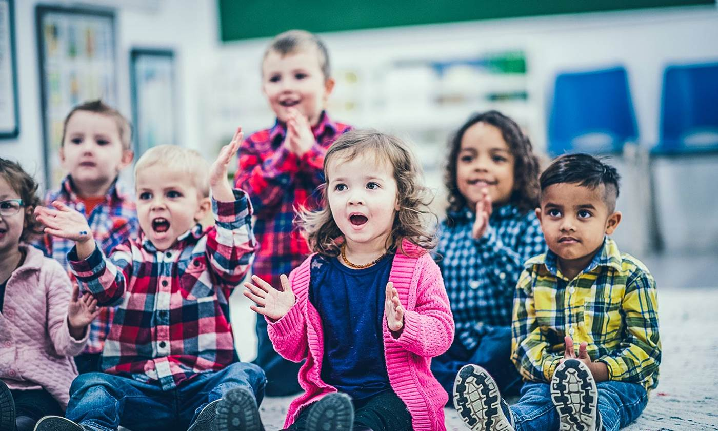Children at an early learning centre clapping to a song