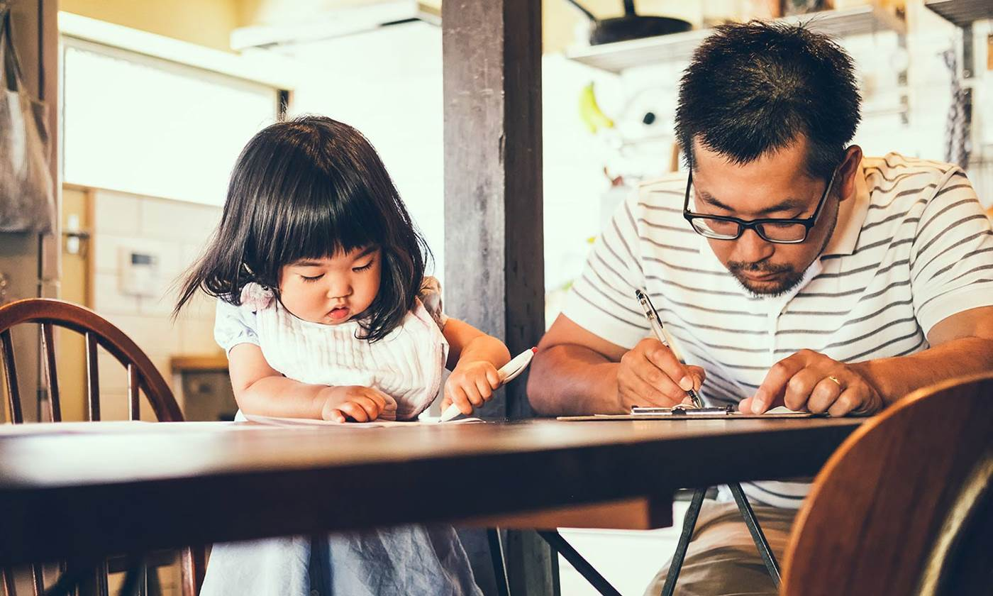 Father and daughter filling out paperwork