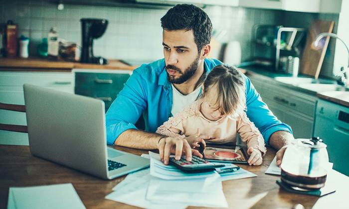 man at computer with daughter