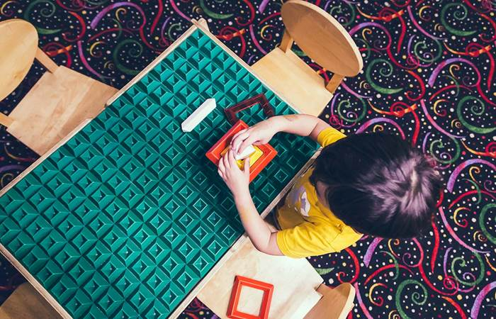 Boy playing at a table