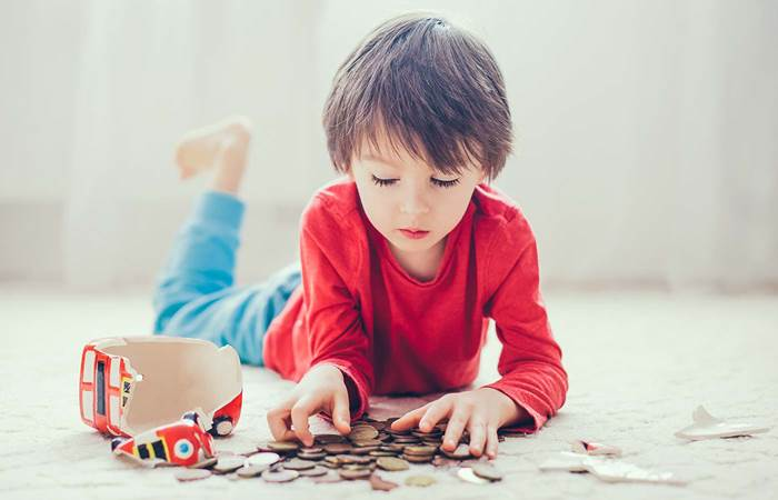 Boy with coins and money box